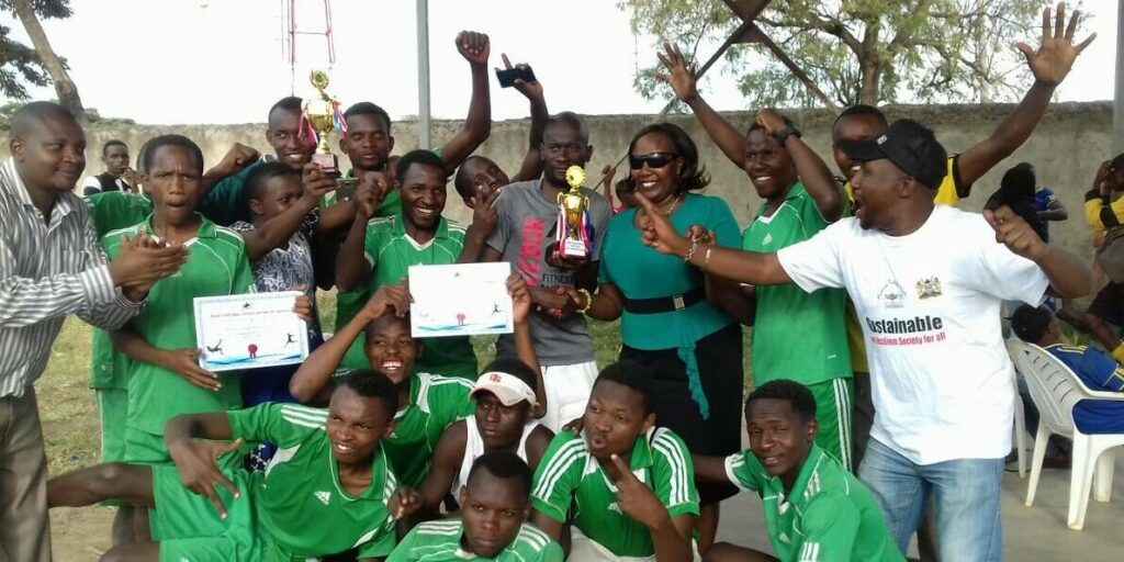 Woman with deafblindness and a soccer team